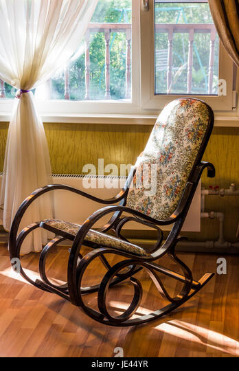 The Rocking Chair In The Living Room Beside The Window   Stock Image