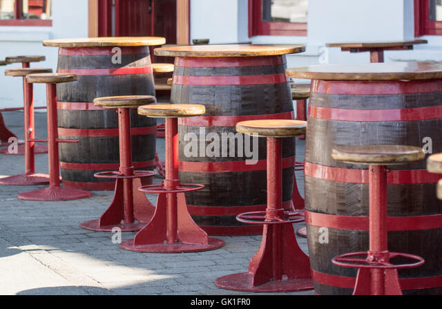 colourful red bar stools and tables made from barrels outside restaurant in baltimore cork