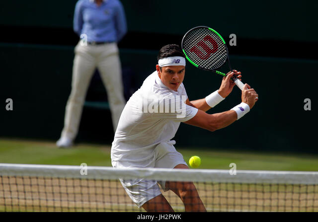 London, UK. 12th July, 2017. Wimbledon Tennis: London, 12 July, 2017 - Milos Raonic at net for a volley during his - Stock Image