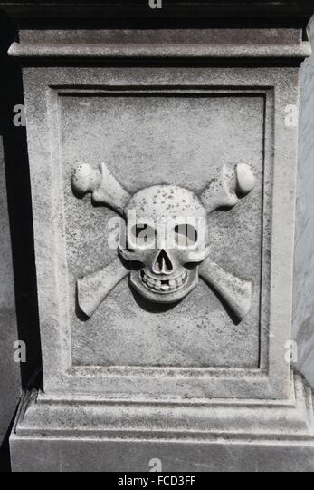 Stone carved skull stock photos