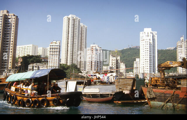 Contrasts of typical vessels; residences; Hong Kong; China - Stock Image