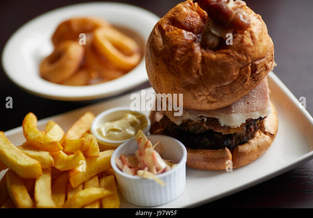 Traditional pub food, Burger and chips. - Stock Image