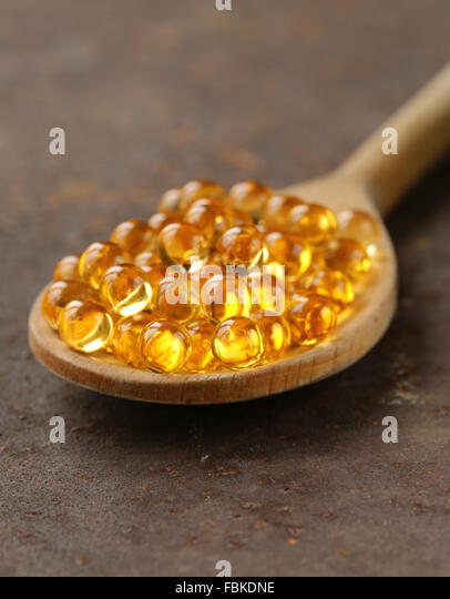 Cod liver oil and spoon stock photos cod liver oil and for Fish oil for cooking