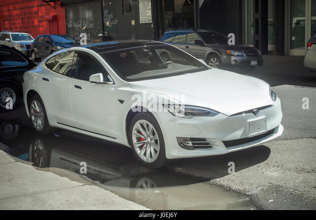 Tesla Electric Car Parked In Stock Photos Tesla Electric Car Parked In Stock Images Alamy