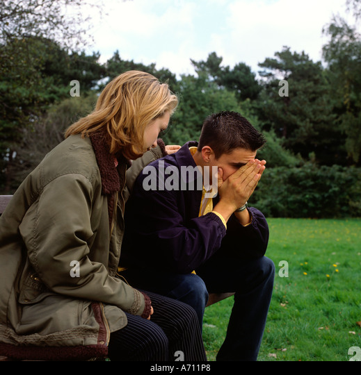 image Young boy comforting lonely widow
