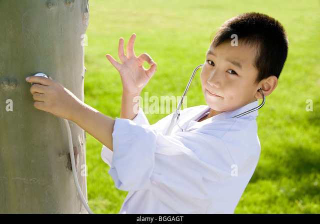 Young Boy Giving A Tree Check Up