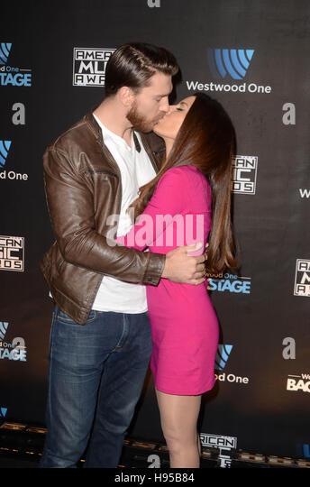 Kerri Kasem sharing a kiss with her boyfriend-turned-husband Jesse Kove