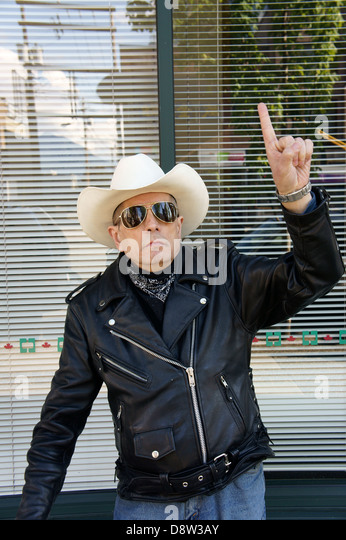 elderly-man-wearing-a-cowboy-hat-giving-