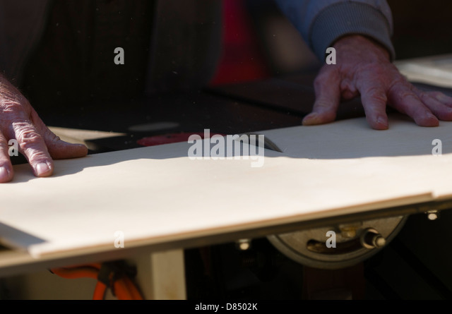 [Image: senior-man-cutting-plywood-on-a-table-saw-d8502k.jpg]