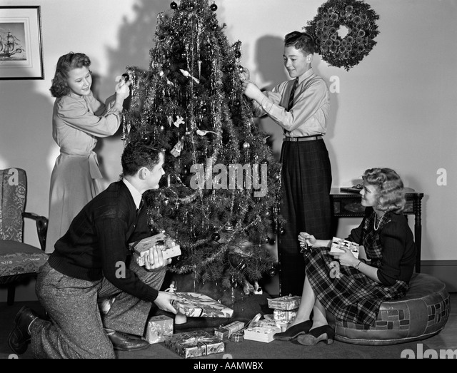 Black People Decorating For Christmas christmas tree indoors black and white stock photos & images - alamy
