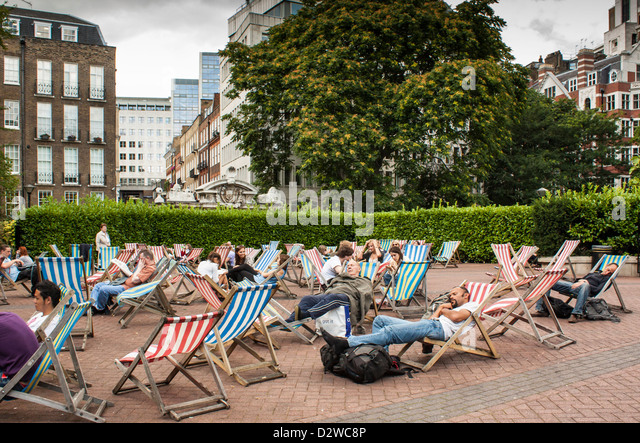 Deckchairs In Victoria Embankment Gardens During The Summertime, London, UK    Stock Image