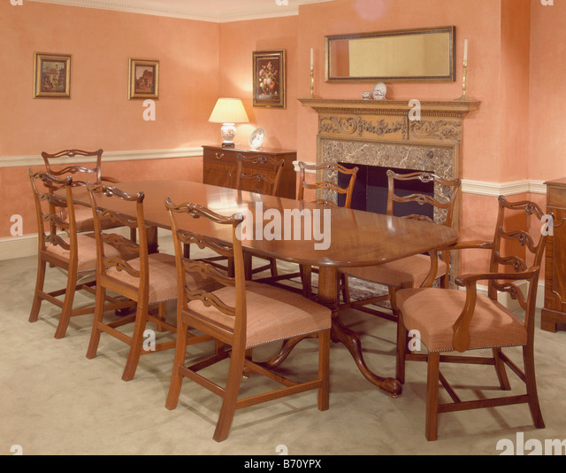 Antique Table And Chairs In Peach Country Dining Room With Lighted Lamp On Corner