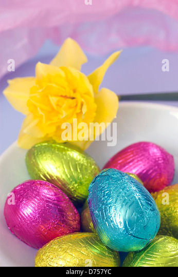 Pink foil wrapped stock photos pink foil wrapped stock images marks and spencers colourful foil wrapped chocolate easter eggs set in a white bowl stock negle Gallery