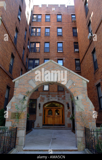 brick apartment building entrance. entrance to an apartment building in sunnyside queens nyc - stock image brick