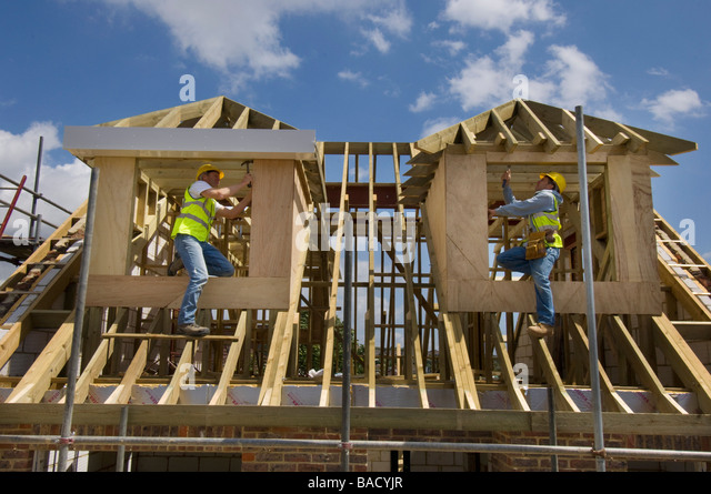 Carpenters working on the roof of a new house. - Stock Image & Carpenters Working Roof House Stock Photos u0026 Carpenters Working ... memphite.com