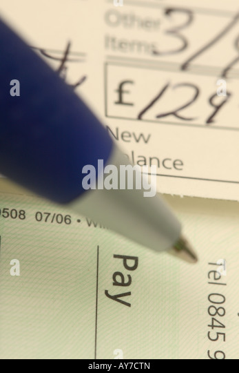Cheque bank uk stock photos cheque bank uk stock images alamy writing a bank cheque book payment bill cost amount stock image ccuart Images