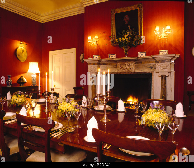 Interiors diningroom fireplace traditional stock photos for Traditional red dining room