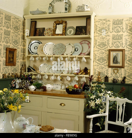 Cream Painted Dresser And Wallpaper In Eighties Dining Room