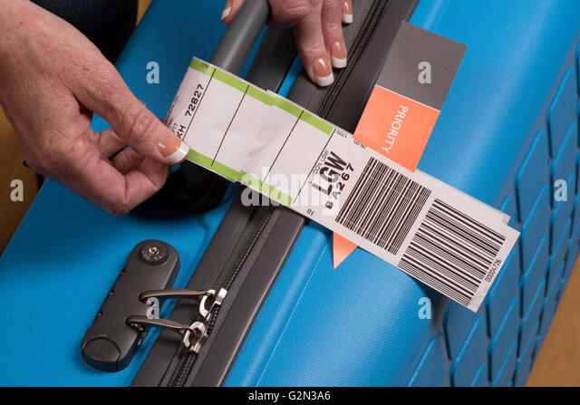 Priority Tag: Airline Baggage Tag On Suitcase Stock Photos & Airline