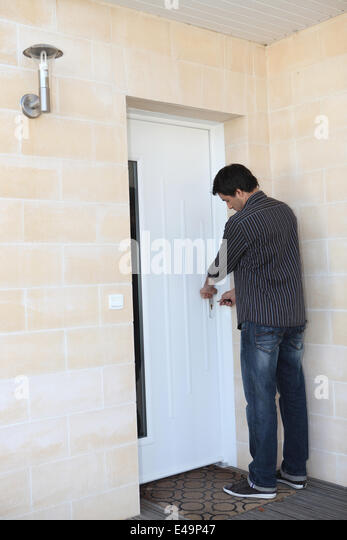 person locking door. Man Locking His Door Person