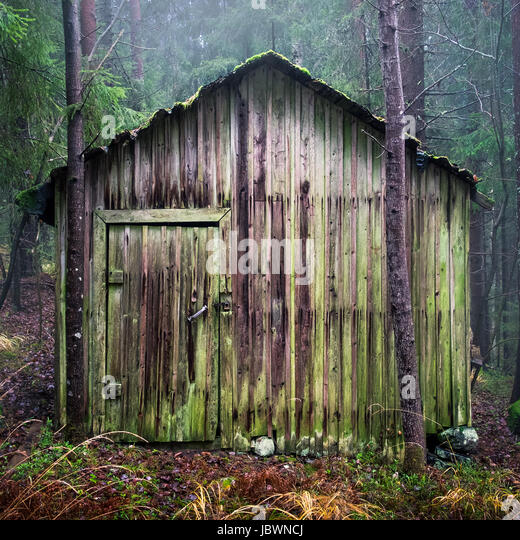 Old and abandoned shed with gloomy foggy weather at rainy day - Stock Image