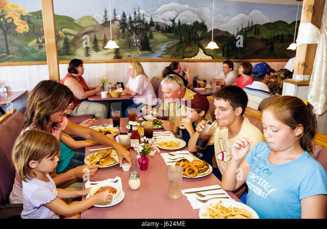 Indiana Kouts Joy's Family Restaurant comfort food woman man boy girl family meal eat hungry fries cheeseburger - Stock Image
