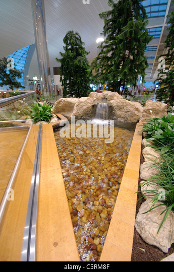Indoor garden fountains stock photos indoor garden fountains stock dubai international airport new terminal 3 exclusively for emirates airlines dubai united workwithnaturefo