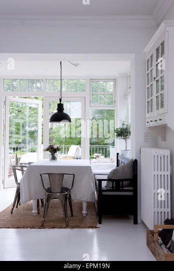 Dining Room With Chrome Chairs And Door Open To Garden In Hanne Davidsen Home Renovation