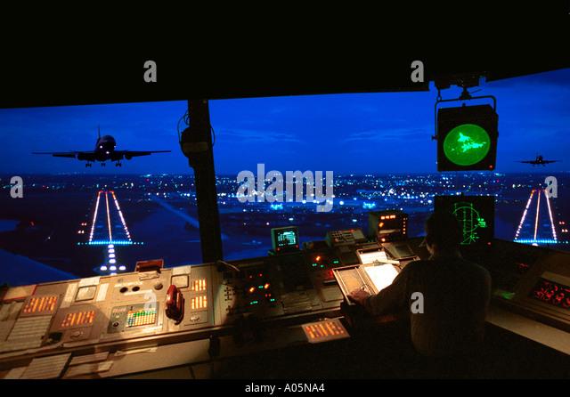 Air traffic control tower at night