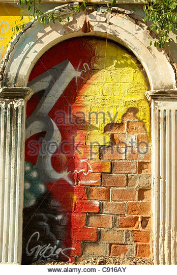 mural-on-a-brick-wall-framed-by-arch-in-