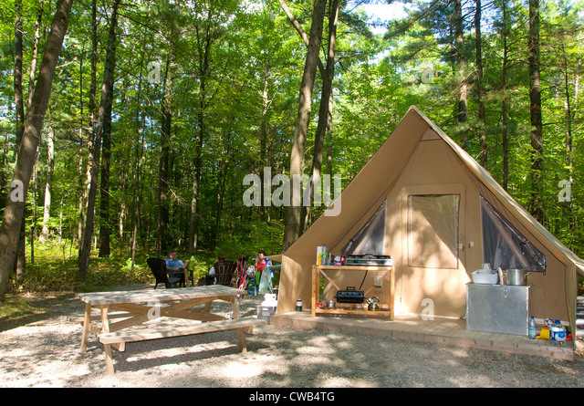 In Quebec foreign tourists and local people are discovering a new way of c&ing with the & Camping Quebec Huttopia Tent Stock Photos u0026 Camping Quebec ...