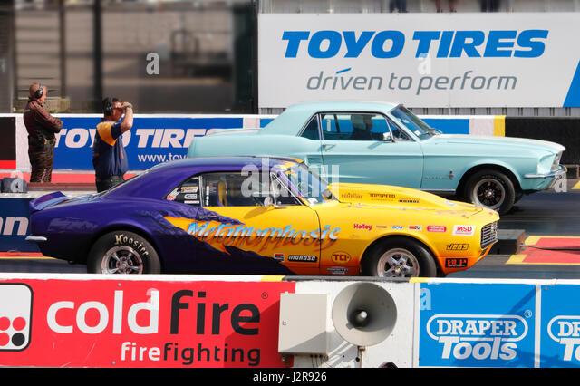 A Ford Mustang And Chevy Camaro At The Santa Pod Raceway   Stock Image
