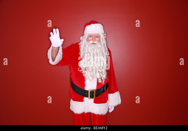 Waving santa claus stock photos