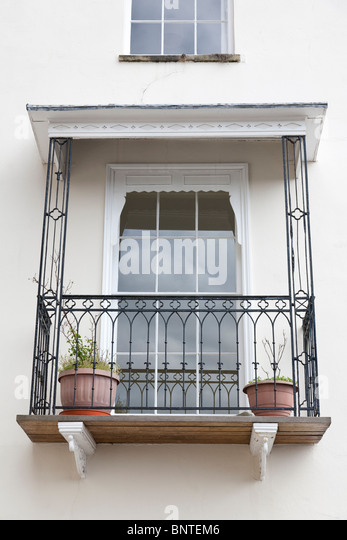 Wrought iron balcony railings stock photos wrought iron balcony railings stock images alamy - Houses with covered balconies ...