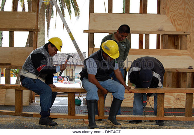 Construction Site Shot Mexico Mexican Carpenters Building Stage For Outdoor Concert Four Workers Natural Light