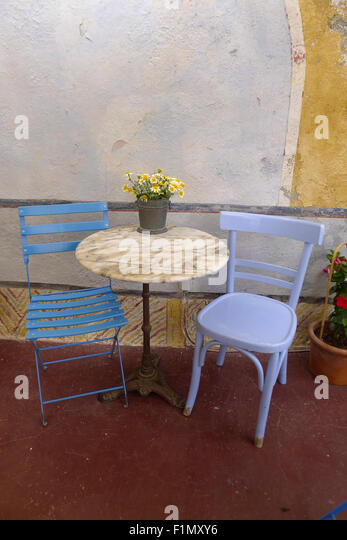 Greek blue table and chairs stock photos