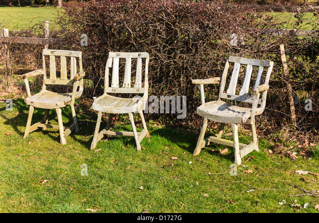 Three Traditional Green Oak Garden Chairs At Emsworth Hampshire Uk Stock Image