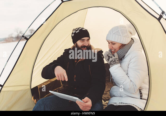 enamored happy couple sitting in tourist tent with white tablet in hands watching movie and  sc 1 st  Alamy & Camping Hipster Couple In Tent Stock Photos u0026 Camping Hipster ...