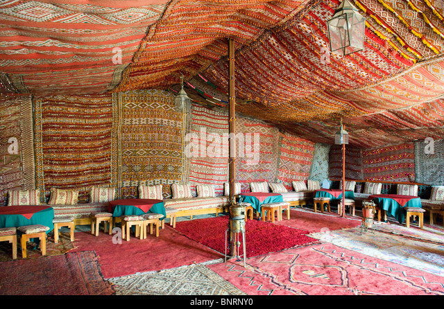 The Interior Of A Berber Carpeted Tent Used As A Restaurant, In Ouarzazate,  Morocco