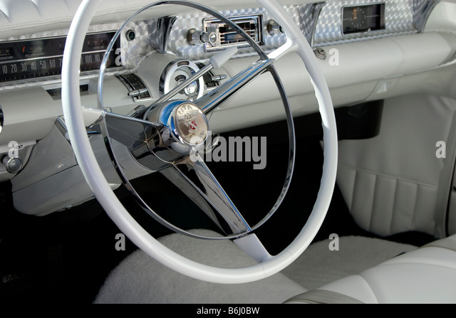 buick steering wheel at an antique car show stock image