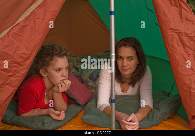 Two teenage girls c&ing in a pup tent. - Stock Image  sc 1 st  Alamy & Pup Tent Stock Photos u0026 Pup Tent Stock Images - Alamy