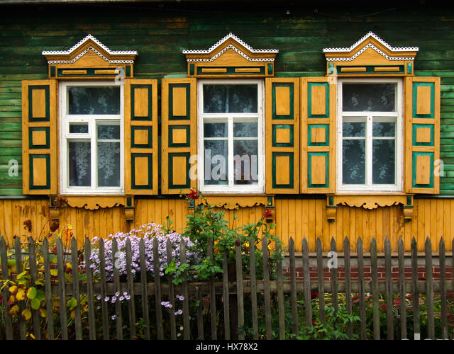 a traditional russian house made of wood or timbers and with nalichniki fancy decorative