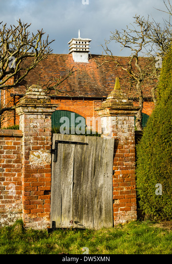 Superb Dovecote On The Roof Of Outbuildings And Old Garden Gate At Packwood House  In Warwickshire UK