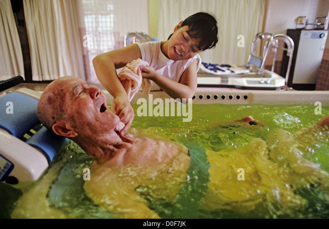 Bathing Elderly Japanese Woman Stock Photos & Bathing Elderly ...
