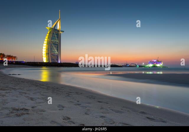 Burj Al Arab Hotel after sunset on Jumeirah Beach, Dubai, United Arab Emirates, Middle East - Stock Image