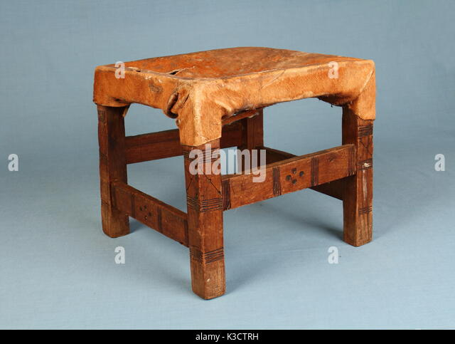 Milking Bench Part - 18: Traditional Handmade African Milking Stool Made From Wood And Animal Hide  In Landscape Format Against A