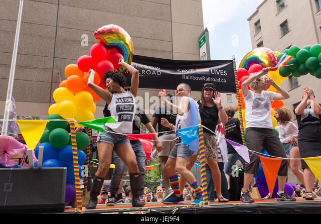 Toronto, Canada. 25 June 2017. People take part in Toronto Pride Parade. Credit: Marc Bruxelle/Alamy Live News - Stock Image