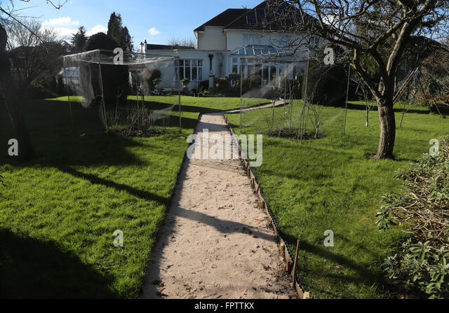 Laying New Garden Path   Lawn Edging Strip Surrey England   Stock Image
