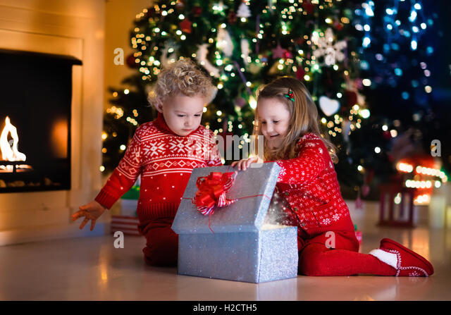 Opening Presents Christmas And Fire Stock Photos & Opening ...
