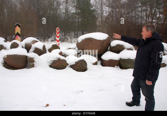 Mayor Of Blankensee Siegfried Dressler Points To A Border Crossing In A  Field Blocked With Stones